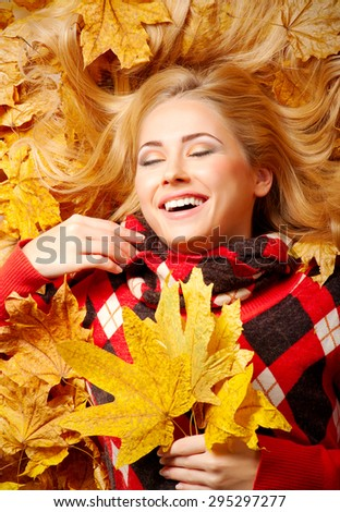 Young smiling woman in red sweater - stock photo