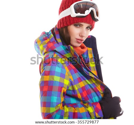 Young smiling woman is posing with ski goggles in studio, isolated on white background. - stock photo