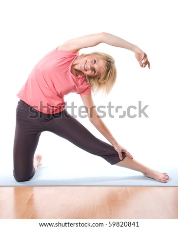 Young smiling woman making fitness - stock photo