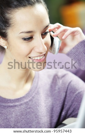 young smiling woman on phone - stock photo