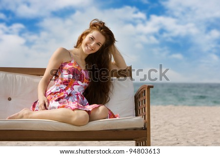 young smiling woman on sea background - stock photo