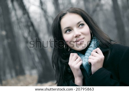 Young smiling woman outdoors portrait. - stock photo