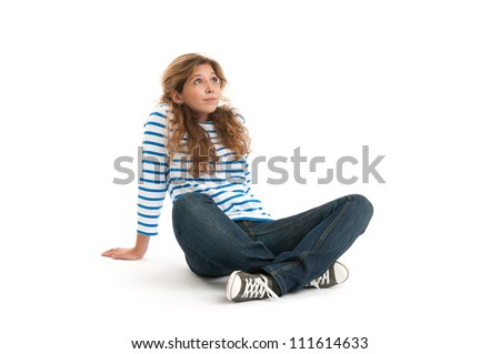 young smiling woman sitting on white and looking up - stock photo