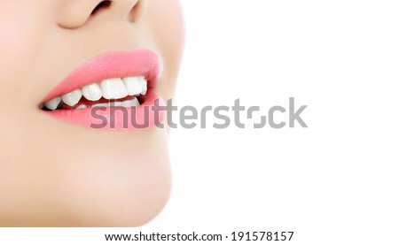 Young smiling woman, white background, copyspace  - stock photo