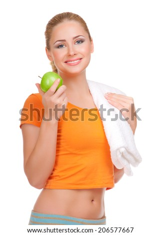 Young smiling woman with apple isolated - stock photo