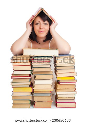 Young smiling woman with heap of books isolated - stock photo