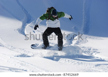Young Snowboarder having fun with powder snow - stock photo