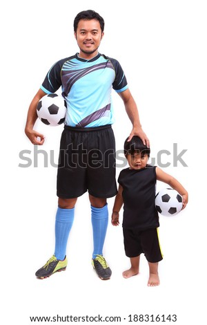 Young soccer football player on white - stock photo