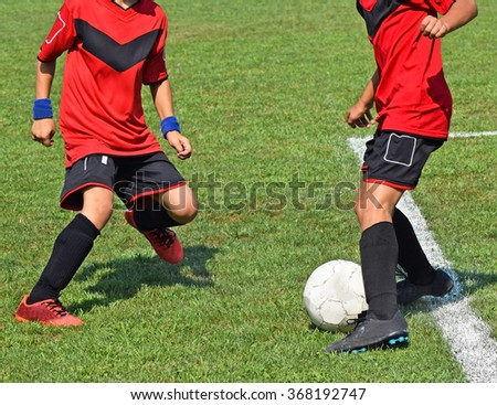 Young soccer players in action - stock photo