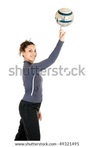 young soccer woman making ball rolling on finger - stock photo