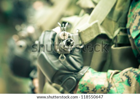 young soldiers ready for combat with assault rifles - stock photo