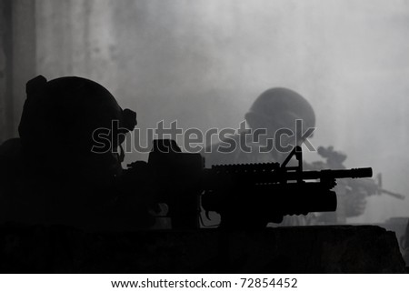 young soldiers with guns - stock photo