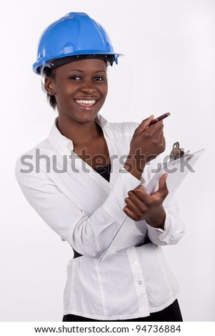 Young South African in hard hat smiling. - stock photo