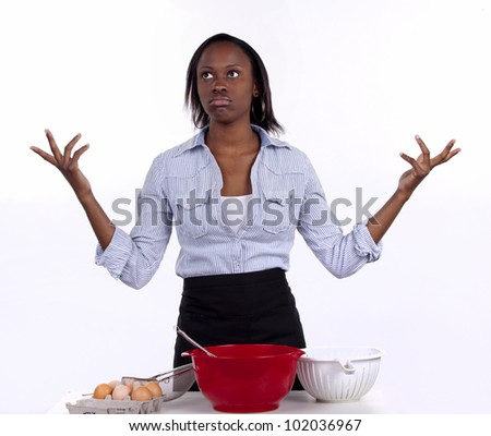 Young South African woman looking clueless about baking. - stock photo