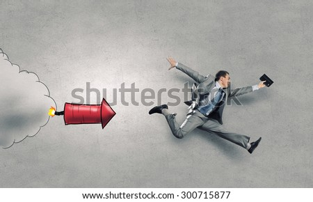Young speedy businessman running in a hurry - stock photo