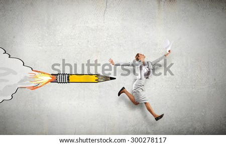 Young speedy businesswoman running in a hurry - stock photo