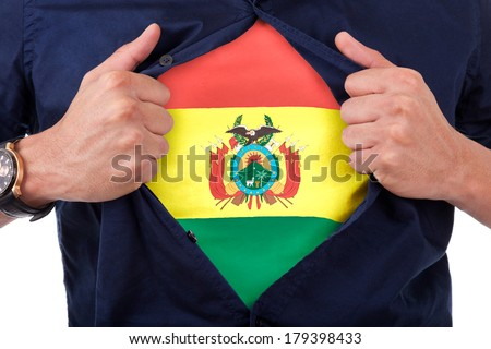 Young sport fan opening his shirt and showing the flag his country Bolivia, Bolivian flag - stock photo