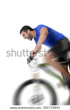 young sport man riding mountain bike training hard on sprint in fitness and competition concept with excited face expression isolated on white background with harsh motion blur - stock photo