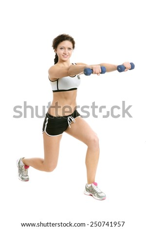 Young sport woman with dumbbells, full length on white background - stock photo