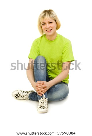 Young sports girl sitting on a white background - stock photo