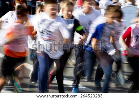 Young sportsmen running a cross - stock photo