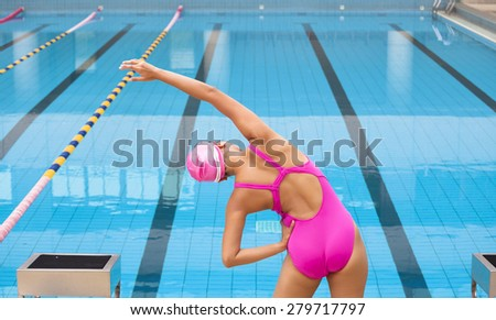 Young sportswoman stretching and preparing to swimming - stock photo