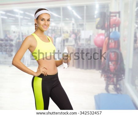 Young sporty girl in fitness club - stock photo