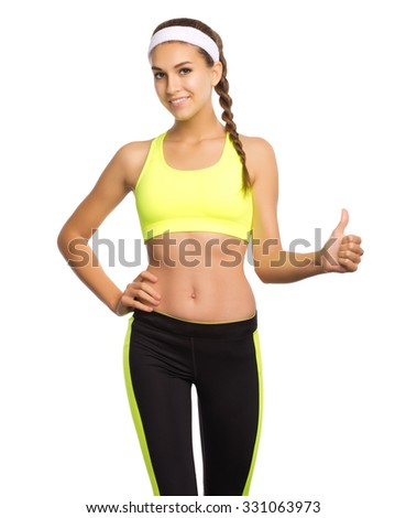 Young sporty girl shows ok gesture isolated - stock photo