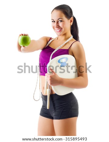 Young sporty girl with scales and apple isolated - stock photo