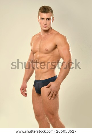 Young ,sporty, handsome man with  naked torso - stock photo