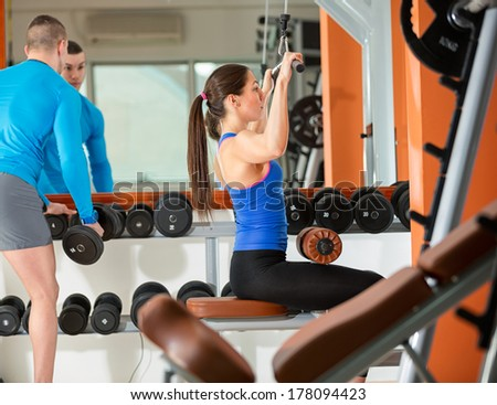 young sporty people exercising at gym  - stock photo