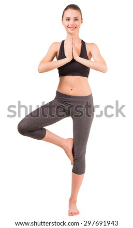 Young sporty woman standing and meditating on white background. - stock photo
