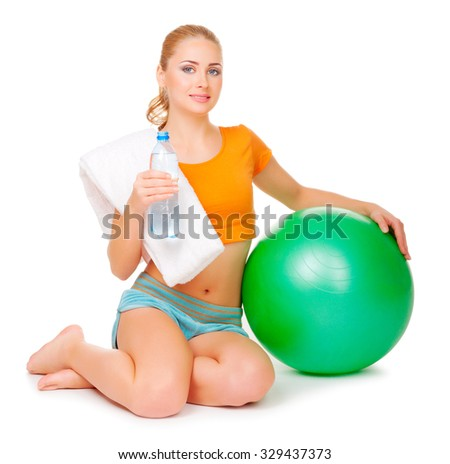 Young sporty woman with ball isolated - stock photo