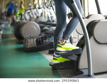 Young sporty women doing exercises in the gym centre. Closeup - stock photo