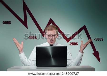 Young stock exchange worker dealing with crisis - stock photo
