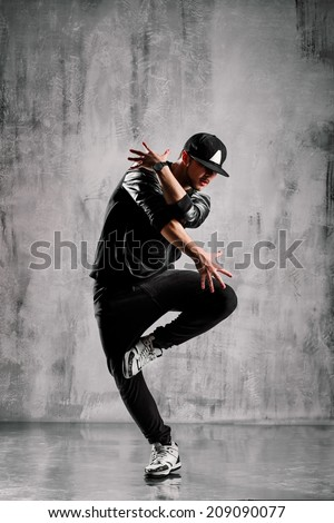 young street style dancer posing on studio background - stock photo