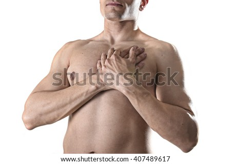 young strong body sport man with hands on his torso covering his heart in chest pain coronary problems and infarct concept isolated on white background - stock photo