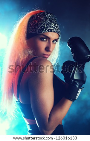 Young strong boxer woman portrait. - stock photo