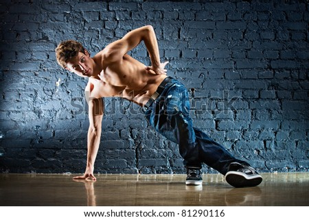 Young strong man break dance. - stock photo