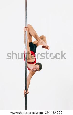 Young strong pole dance man doing split grip chinese rubber aysha - stock photo