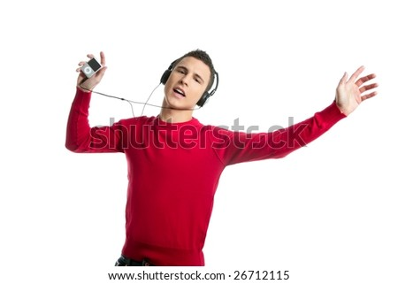 Young student boy dress in red hearing mp3 music, studio isolated on white - stock photo