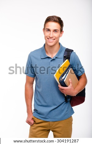 Young student boy smiling, looking at camera and holding books. Isolated on white background - stock photo