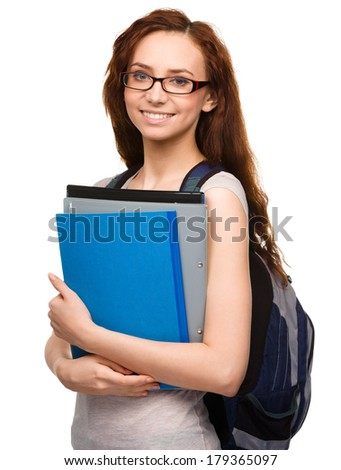 Young student girl is holding exercise book, isolated over white - stock photo