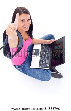 young student girl showing thumb up, top view - stock photo