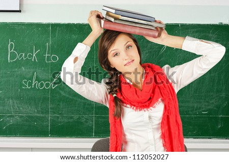 Young student girl with her books - stock photo
