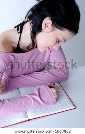 young student girl writing in diary - stock photo