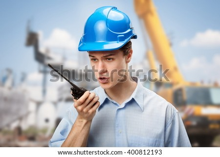 Young student learning to communicate and make decisions on construction site - stock photo