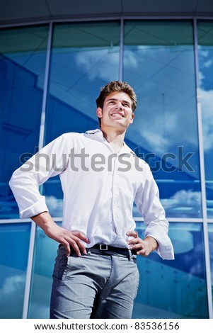 Young student near university. - stock photo