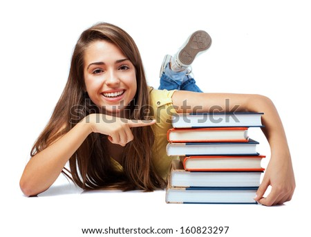 young student woman lying holding a books pile - stock photo