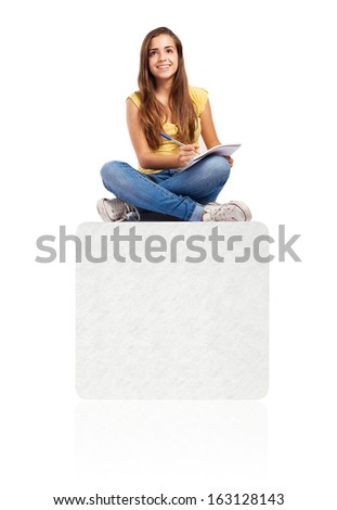 young student woman sitting on a box and studying - stock photo